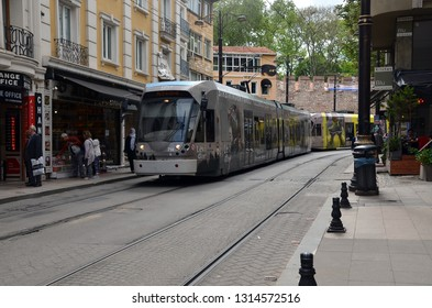 ISTANBUL, TURKEY - MAY 11, 2018 - Long  Istanbul tram on the narrow street of Istanbul, Turkey