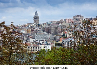 ISTANBUL, TURKEY — MAY 12, 2011. Galata Tower and buildings in the Beyoglu District are viewed across the waters of the Golden Horn on a sunny spring day with blue sky and clouds.
