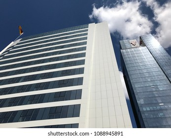 Istanbul, Turkey - May 12, 2018: Torun Center towers rising against the blue cloudy sky. The commercial complex in Mecidiyekoy district has offices, residences, malls, hotel, cinema and theather.