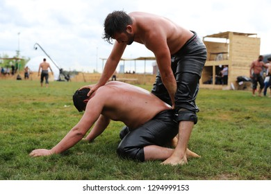 ISTANBUL, TURKEY - MAY 12, 2018: Oil wrestlers compete during Etnospor Culture Festival. Oil wrestling also called grease wrestling is the Turkish traditional sport. - Image