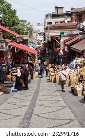 ISTANBUL, TURKEY - MAY 14, 2014 - Locals and tourists mingle in the backstreet markets near Suleymanie Mosque,  in Istanbul, Turkey