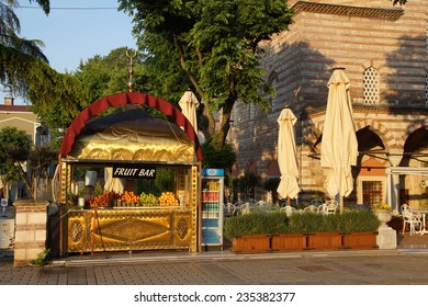 ISTANBUL, TURKEY - MAY 14, 2014 - Dawn brightens a fruit bar  on the square between Hagia Sophia and the Blue Mosque,  in Istanbul, Turkey
