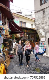 ISTANBUL, TURKEY - MAY 14, 2014 - Young Muslim women shopping near the Egyptian market  in Istanbul, Turkey
