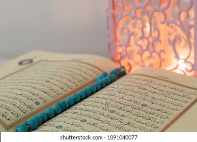Istanbul / Turkey - May 14, 2018 ;Koran and rosary beads on the white background with pink lantern light for Islamic concept. Holy book Quran for Muslims for Ramadan,blessed Friday message.