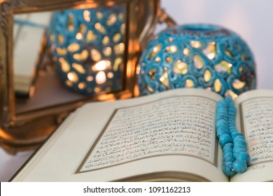 Istanbul / Turkey - May 14, 2018 ; Koran and rosary beads with blue soft light lantern for Islamic concept. Holy book Quran for Muslims for Ramadan,blessed Friday message and three months.
