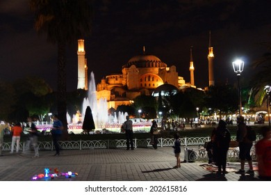 ISTANBUL, TURKEY - MAY 15, 2014 -Late night walkers view the lighted Hagia Sophia  in Istanbul, Turkey