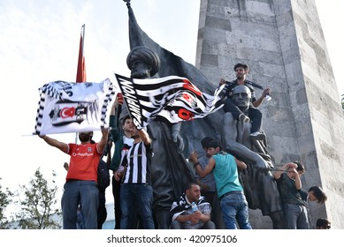 Istanbul, Turkey - May 15, 2016: A crowded group of fans supporters marching towards Inonu Stadium in Besiktas to support their football club, BJK - Turkey, Istanbul