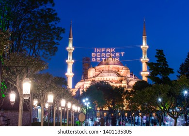 ISTANBUL, TURKEY - MAY 16, 2019: In Ramadan month Islamic message lettering hanging on Blue Mosque's mahya. Mahya is an enlightenment arrangement during ramadan nights between two minarets.