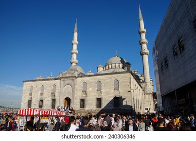 ISTANBUL, TURKEY - MAY 17, 2014 -Crowds form in front of the Yeni Camii mosque on the Goldern Horn,  in Istanbul, Turkey