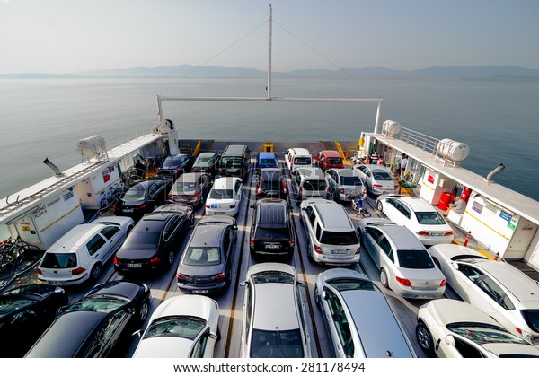 ISTANBUL, TURKEY - MAY 17 2015:  Top view of vehicle and passenger ferry. Ferry boats often dock at specialized facilities designed to position the boat for loading and unloading called a ferry slip.