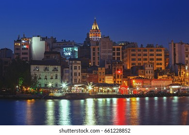 ISTANBUL, TURKEY - MAY 2, 2017: Galata tower, Karakoy district and Golden Horn at night with illumination