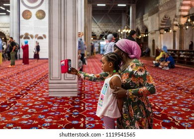 Istanbul, Turkey - May 20, 2018: Mother and daughter make a selfie in the Blue Mosque Sultan Ahmed.