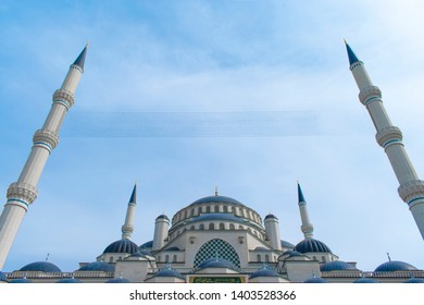 Istanbul Turkey /May 2019 Istanbul Camlica Mosque (Turkish: Camlica Camii). The biggest mosque in Turkey. Mosque with dome and minarets, blue sky and mahya (Mahya English: ridge minaret mosque)