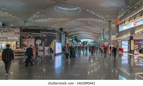 Istanbul, Turkey - May 2019: Interior view of new Istanbul Airport with passengers walking and passing time until departure time, Turkey