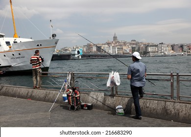 ISTANBUL, TURKEY - MAY 21: Fishing from the waterfront promenade in Istanbul. May 21, 2011 in Istanbul, Turkey