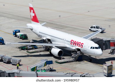 ISTANBUL , TURKEY - MAY 23, 2014: Aircraft of Swiss Airlines, is parking at  Istanbul Ataturk International Airport on May 23, 2014. The aircraft is an Airbus A-320