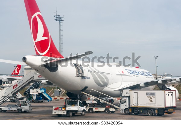 ISTANBUL, TURKEY - MAY 23, 2016: Big white airplane in airport serviced by the ground crew.