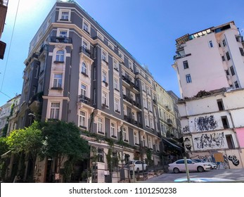 Istanbul, Turkey - May 23, 2018: Generic architecture and residential buildings in Cihangir, Tophane district of Beyoglu, Istanbul. The district is full of hip cafes, stores and hotels.