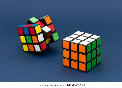 ISTANBUL - TURKEY - MAY 25, 2019: Solving and unsolving variation of the Rubik's cube on a blue background. Rubik's Cube invented by a Hungarian architect Erno Rubik in 1974.