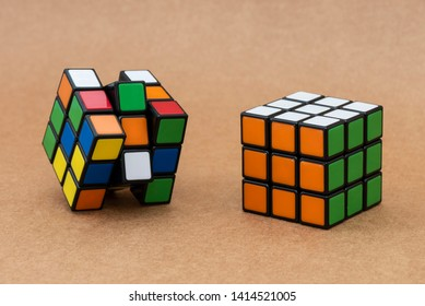 ISTANBUL - TURKEY - MAY 25, 2019: Solving and unsolving variation of the Rubik's cube on a craft background. Rubik's Cube invented by a Hungarian architect Erno Rubik in 1974.
