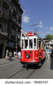 ISTANBUL, TURKEY - MAY 25 : An unidentified  man rides a tram on Istiklal Street,on May 25, 2011 in Istanbul, Turkey.Istiklal Street is a busy pedestrian shopping street leading to Taksim Square in Istanbul.