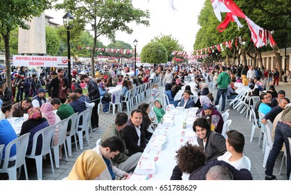 ISTANBUL, TURKEY - MAY 27, 2017: People waiting for the evening meal during Ramadan in Sultanahmet square. Sultanahmet district is the most populer place for Ramadan activities in Istanbul.
