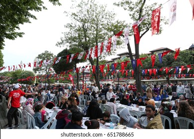 ISTANBUL, TURKEY - MAY 27, 2017: People waiting for the evening meal during Ramadan in Sultanahmet square.  Sultanahmet district is the most popular place for Ramadan activities in Istanbul.