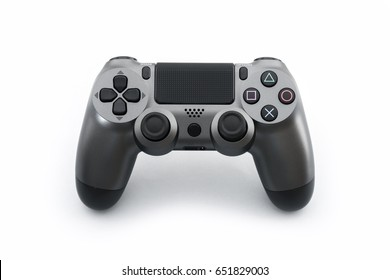 ISTANBUL, TURKEY - MAY 28, 2017: The new Sony Dualshock 4 white color is on the blue background. Sony PlayStation 4 game console of the eighth generation.