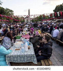 ISTANBUL, TURKEY - MAY 28, 2017: People are eating the evening meal during Ramadan in Sultanahmet square. Sultanahmet district is the most popular place for Ramadan activities in Istanbul.