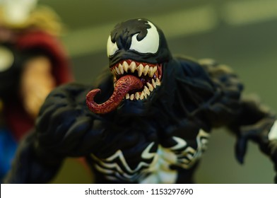 Istanbul, Turkey - May 29, 2014: Collectible Venom super hero and movie character figurine in the showcase of a comic store