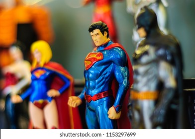 Istanbul, Turkey - May 29, 2014: Collectible Superman, Batman, Supergirl super hero and movie character figurines in the showcase of a comic store