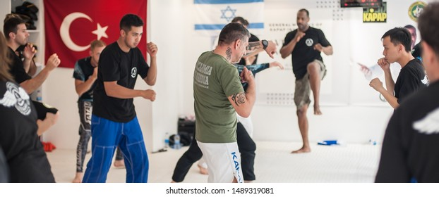 ISTANBUL, TURKEY - May 30 - Jun 02. 2019. Kapap instructor Roberto Lerici from Italy, demonstrates escrima stick fighting to large group of students on GENERAL MEETING OF KAPAP INSTRUCTORS
