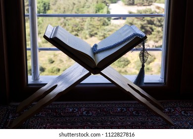 Istanbul / Turkey - May 31, 2018 ; Koran and rosary beads on the lectern in front of the window for Islamic concept. Holy book quran for Muslims for Ramadan and Friday message.