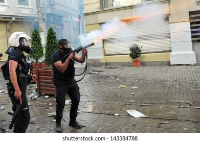 ISTANBUL, TURKEY - MAY 31: Police intervenes Gezi Park demonstrators with pepper gas at Taksim on May 31, 2013 in Istanbul, Turkey.