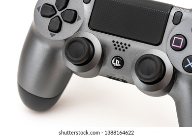 ISTANBUL, TURKEY - MAY 4, 2019: The new Sony Dualshock 4 white and gunmetal color is on the white background. Sony PlayStation 4 game console of the eighth generation.