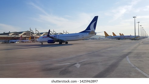ISTANBUL, TURKEY - MAY 4, 2019: AnadoluJet airplane parking at Sabiha Gokcen International Airport. Anadolu Jet is a fully owned subsidiary of Turkish Airlines.