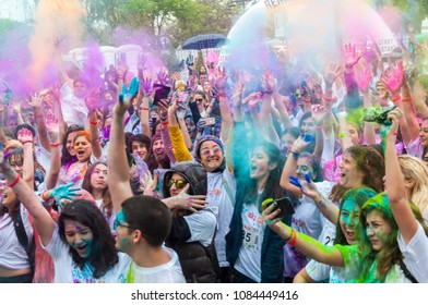 ISTANBUL, TURKEY - MAY 6, 2018: Color Sky 5K, Color Running Festival in Istanbul, Turkey.  People dancing and celebrating during the color throw.
