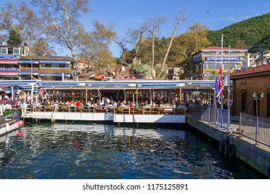 Istanbul, Turkey - November 10, 2013: Fish restaurants by the sea side at Anadolu Kavagi located beside the ferry terminal, View from the sea