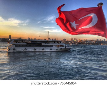ISTANBUL, TURKEY -  NOVEMBER 10, 2017: Turkish flag and ferry boat,Istanbul cityscape. travel to Istanbul. Sea voyage on the old ferryboat, Istanbul's water transport Istanbul, Turkey