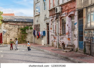 Istanbul, Turkey, November 13, 2012: Three small chidren playing in a street in Balat district.