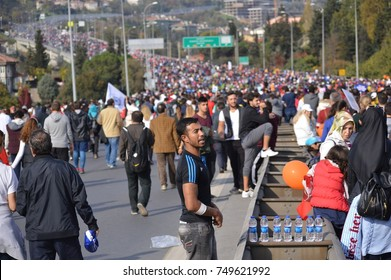 ISTANBUL, TURKEY - NOVEMBER 15, 2015: Turkish people cross the 15 Temmuz Demokrasi ve Sehitler Koprusu (Bosphorus Bridge) in 37. Istanbul Marathon from the Asia to Europe with families and friends.