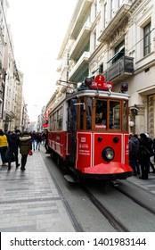 Istanbul, Turkey - November 17, 2018. Istiklal avenue with crowded people and Istiklal Tram Istanbul Beyoglu Turkey.