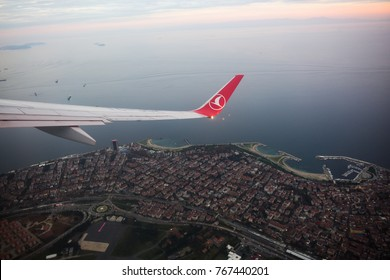 Istanbul, Turkey - November 23, 2017: Yesilkoy district center is pictured through the window of a Turkish Airlines (THY) aircraft it landing from Ataturk International airport