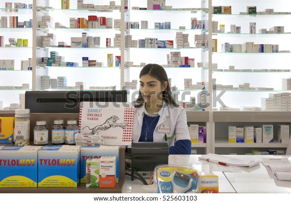 Istanbul, Turkey - November 28,2016;Young female pharmacist working in pharmacy. Atlaspark Pharmacy Atlas Park shopping center Sultanbeyli, Istanbul, Turkey.