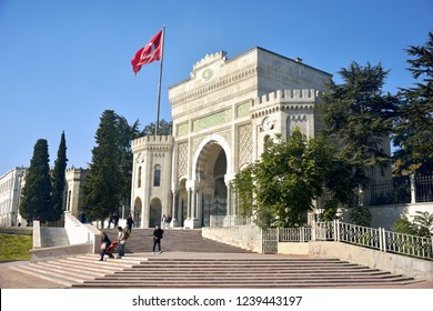 Istanbul, Turkey - November 4, 2015. The portal of Istanbul University at Beyazit Meydani, with people and Turkish flag.