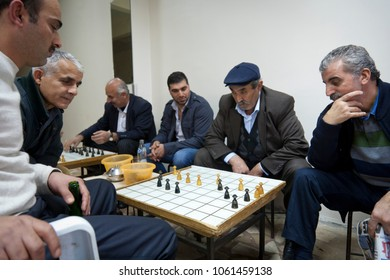 ISTANBUL, TURKEY - NOVEMBER 7, 2009: Men play traditional board games inside a cafe in the Fatih district of Istanbul.