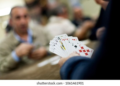 ISTANBUL, TURKEY - NOVEMBER 7, 2009: Close-up of a hand of playing cards held during an all male game inside a cafe in the Fatih district of Istanbul.