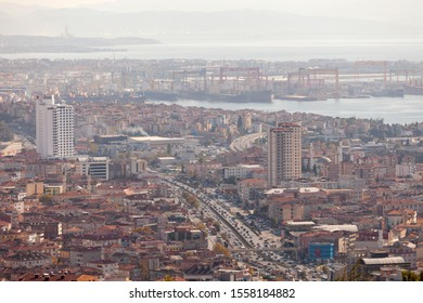 Istanbul, Turkey - November 9 2019 : The Tuzla district of Istanbul has a lot of cranes to build ships and the main road of Istanbul is visible and in focus. Istanbul cityscape view from air.