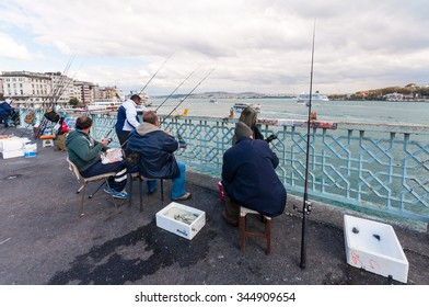 ISTANBUL, TURKEY - OCTOBER 04, 2013: Fishermen enjoy their hobby on the Galata Bridge on October 04,2013 in Istanbul, Turkey.