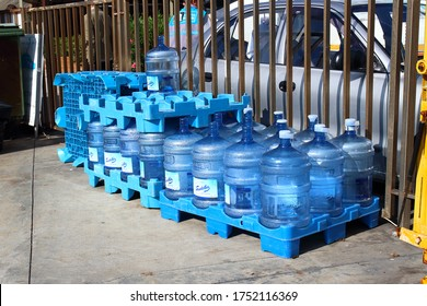 Istanbul, Turkey - October 06, 2019: Empty five-gallon bottles of water on sidewalk. Reusable plastic jugs for filtered water